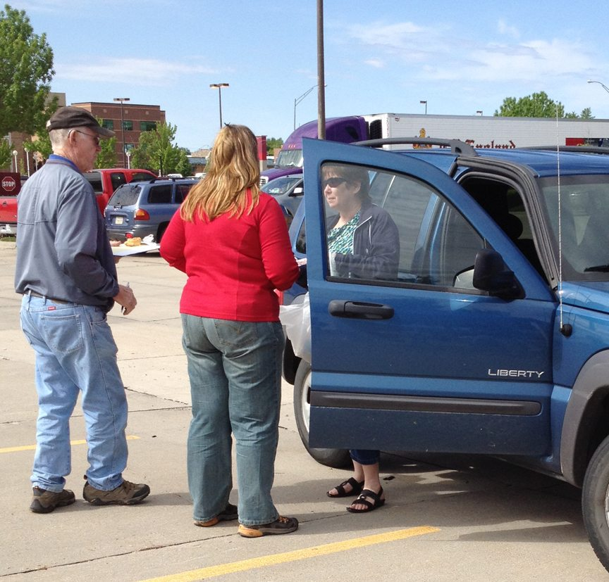 Volunteers Doug Lund an Nikki Bohl collect prescription medications from community members in the parking lot North of Good Samaritan Hospital on Saturday, April 28th.