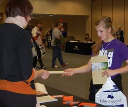 "Molly Klinginsmith (Kearney) receives information from a Nebraska university at the 2011 ""Show Me the Money"" scholarship event."