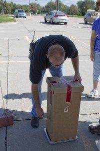 A Buffalo County Sherriff's offcer secures a box of collected medication.
