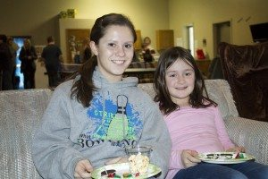 "YAB member Holly Dethlefs spends time with her ""little friend"" at a mentoring event."