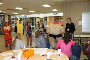 The students had a costume contest to end the meeting. Mason Casper won scariest costume (Tigger), Rowdy Melton won most fruitful costume (banana),Kathleen Juhl won best costume (tourist), Brodrick Paitz won most creative costume (Ghostbuster),Wyatt Hubbard won funniest costume (Sumo),  Colin Ibach won most techy costume (Tech Support guy).